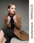 fashionable woman in a coat.... | Shutterstock . vector #789542125