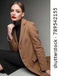 fashionable woman in a coat.... | Shutterstock . vector #789542155