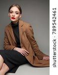 fashionable woman in a coat.... | Shutterstock . vector #789542461