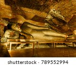 Small photo of The statute of reclining Buddha at Dambulla Cave Temple, the cave temple of Sri Lanka which is the UNESCO World Heritage Site at Dambulla city, Sri Lanka