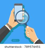 hand holding a magnifying glass.... | Shutterstock .eps vector #789576451