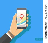 hand holding phone with map and ... | Shutterstock .eps vector #789576454