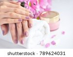 women's hands with pink... | Shutterstock . vector #789624031