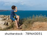 the boy sits on the high... | Shutterstock . vector #789643051