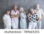 group of seniors leaning... | Shutterstock . vector #789665251