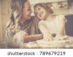 mother and daughter baking... | Shutterstock . vector #789679219