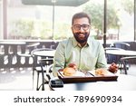 young bearded indian man having ... | Shutterstock . vector #789690934