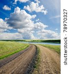 rural road to cloudy horizon - stock photo