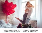 beautiful young couple at home. ... | Shutterstock . vector #789710509