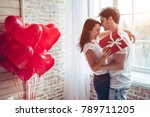 beautiful young couple at home. ... | Shutterstock . vector #789711205