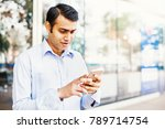 young indian office worker... | Shutterstock . vector #789714754