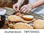 cooking burgers. the process of ...   Shutterstock . vector #789734431