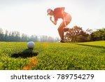 Golfing game. asian woman...
