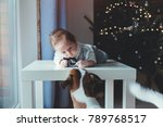 little infant and dog with... | Shutterstock . vector #789768517