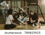young music band sitting on... | Shutterstock . vector #789825925