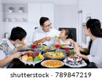 picture of young father feeding ... | Shutterstock . vector #789847219