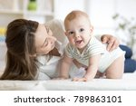 mom and baby boy playing in... | Shutterstock . vector #789863101