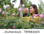 flower and woman | Shutterstock . vector #789882604
