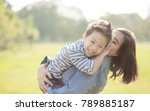 mother and son  in the field.... | Shutterstock . vector #789885187