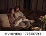 happy couple watching tv on... | Shutterstock . vector #789887065
