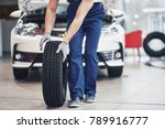 Mechanic holding a tire tire at ...