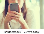Small photo of close up businesswoman hand holding smartphone for checking information from email or playing social media application in free time , technology concept