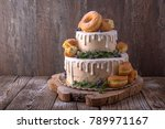Stock photo wedding cake decorated with donuts and wild berries fashionable luxury stylish cake 789971167