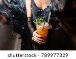 girl in a black dress is... | Shutterstock . vector #789977329