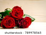 Three Beautiful Red Roses Lie...