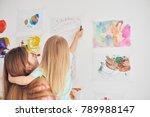 mother and daughter at the wall ... | Shutterstock . vector #789988147