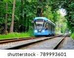 Small photo of MOSCOW, RUSSIA - JULY 23, 2017: The modern Moscow tram model 71-931 Vityaz-M follows its route through the Izmaylovsky park