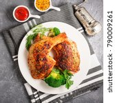 Small photo of Chicken Legs with Vegetables on gray background.Top view.