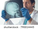 doctor examining x ray of the... | Shutterstock . vector #790014445