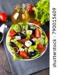fresh greek salad made of... | Shutterstock . vector #790015609
