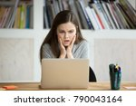 Small photo of Frustrated worried young woman looks at laptop upset by bad news, teenager feels shocked afraid reading negative bullying message, stressed girl troubled with problem online or email notification