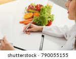 nutritionist doctor writing... | Shutterstock . vector #790055155