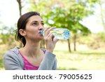 beautiful girl drinking water...   Shutterstock . vector #79005625