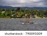 A Lone Sailing Boat Motors...
