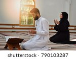 muslim man and woman praying in ... | Shutterstock . vector #790103287