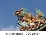 Dragon on the roof - stock photo