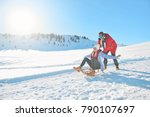 young couple sledding and... | Shutterstock . vector #790107697