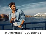 young man listens to music via... | Shutterstock . vector #790108411