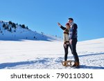 young couple sledding and... | Shutterstock . vector #790110301