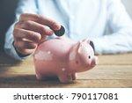 businessman hand coin and piggy ... | Shutterstock . vector #790117081