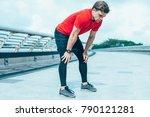 tired sportsman leaning on... | Shutterstock . vector #790121281