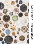 Small photo of Vintage button collection with unique patterns and colors as seen from bird's eye view