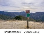 Posted signs showing distances and directions and other notices in Montana de Oro State Park placed on Oats Peak, one of the highest in the park, Los Osos, San Luis Obispo, California