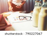 Small photo of Business man working in milk bottle quality control hard job concept, quantity checking in the office, Facility layout planning in the future.