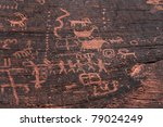 fire canyon weathered fading ancient indian petroglyphs. Some evidence of modern vandalism disfiguring is evident - stock photo