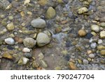 Lots Of Rocks In The Water At...